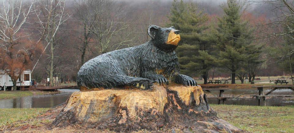 Black bear carving on wooden stump