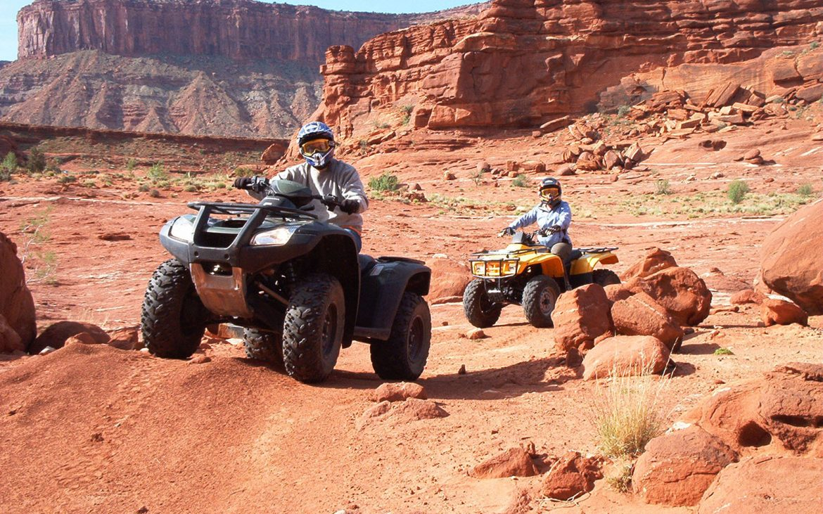 ATV on red surfaced mountain
