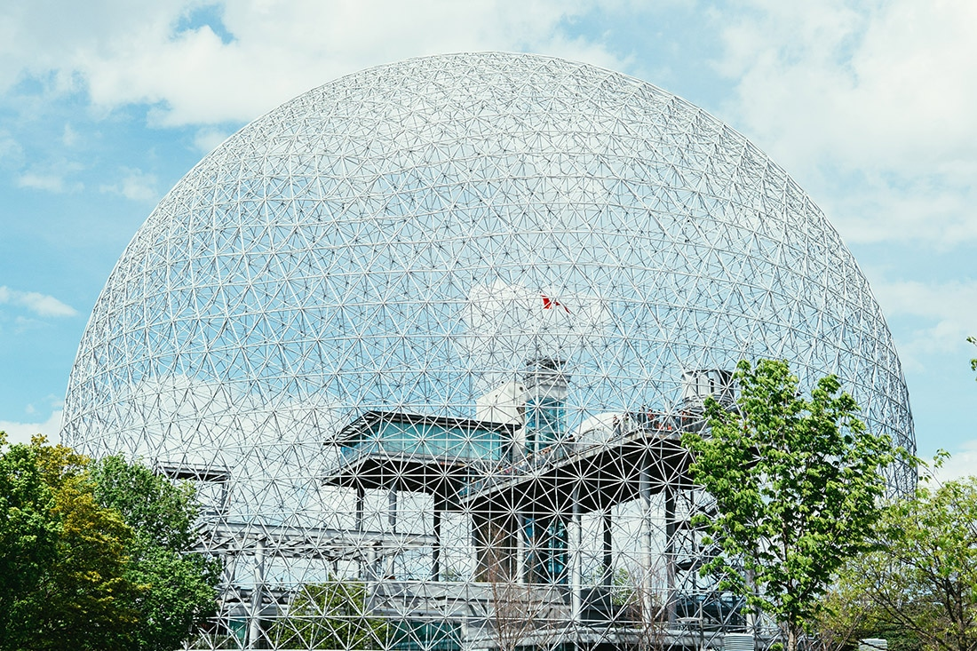 A bubble-like geodesic dome covers Montreal's Biosphere on a sunny day.