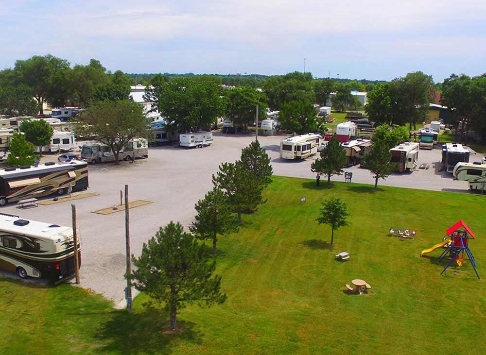 Aerial view of lush greens and trailers