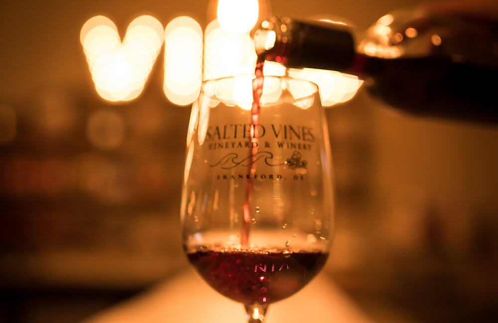 Close up of red wine pouring in wine glass