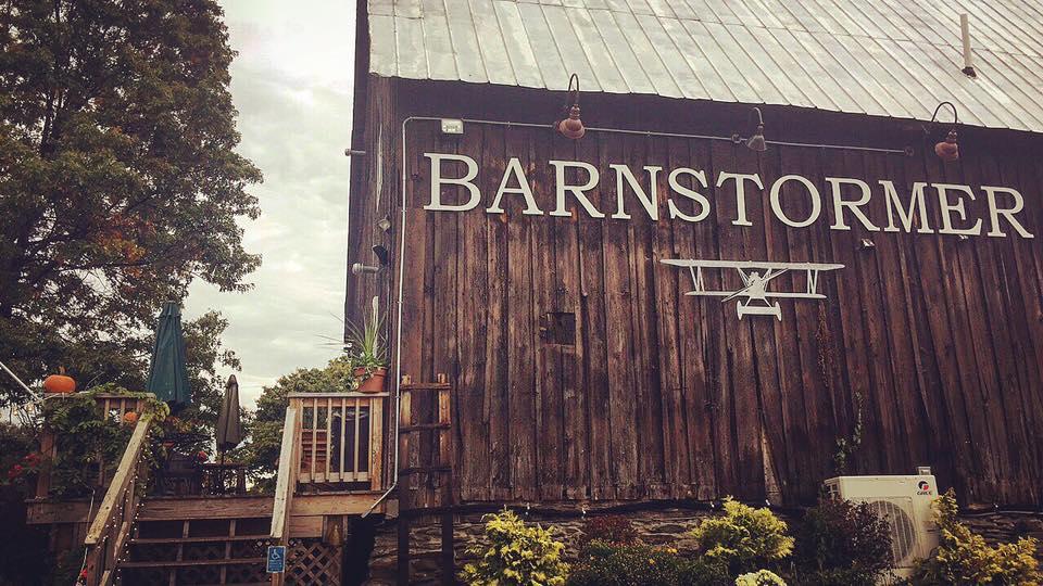Nice barn and patio among vineyard on cloudy day