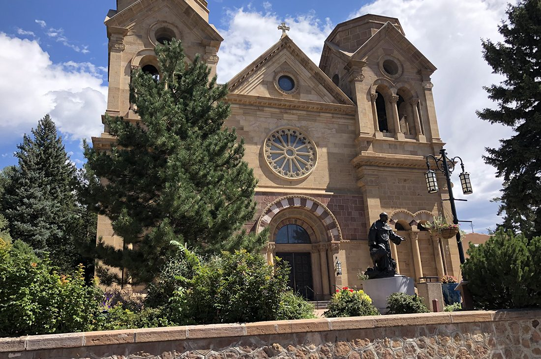 The impressive stone facade of historic Cathedral Basilica of St. Francis of Assisi in Santa Fe.