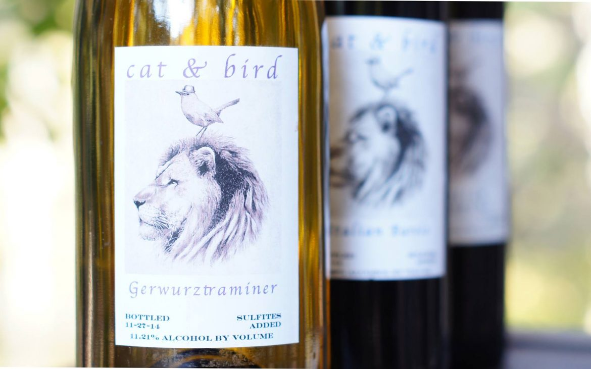 Three wine bottles with lion and bird on label