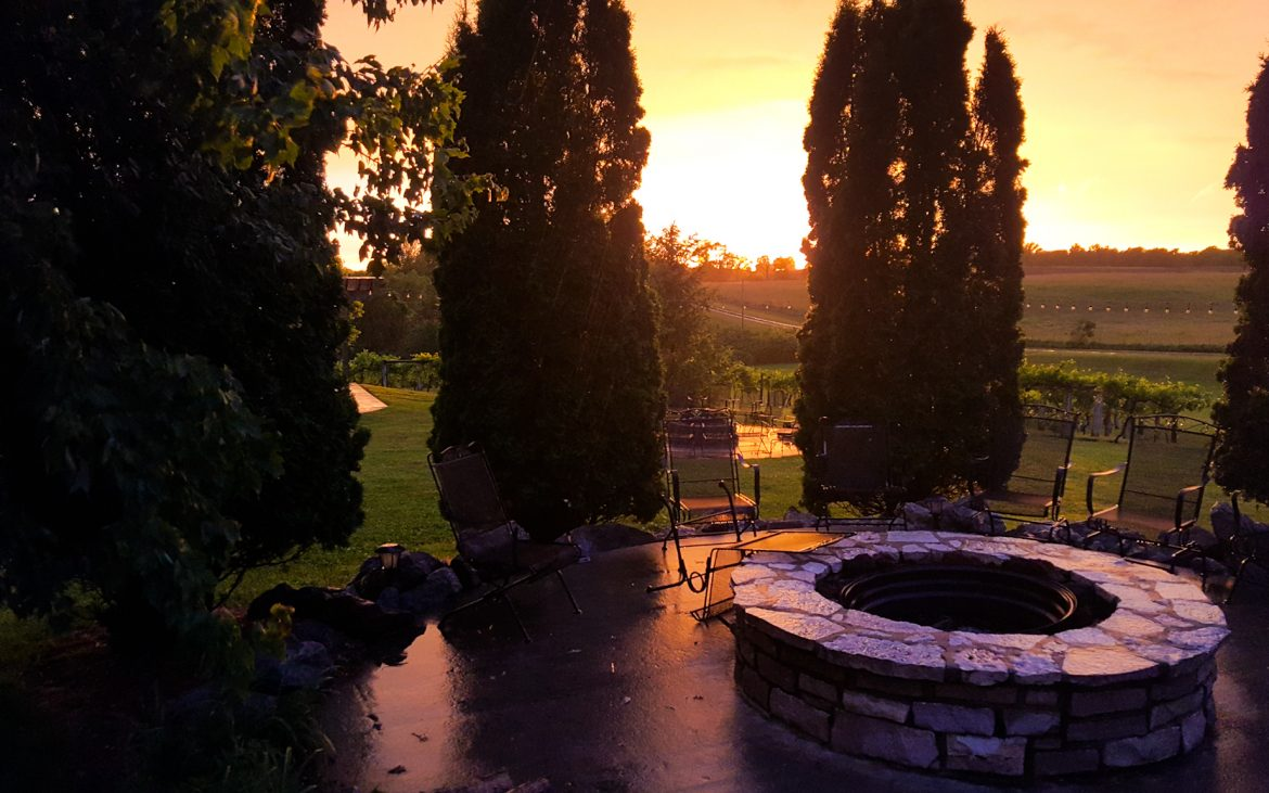 Sunset amidst winery and fire pit
