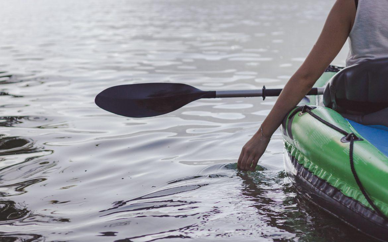 Young woman kayaking on the lake