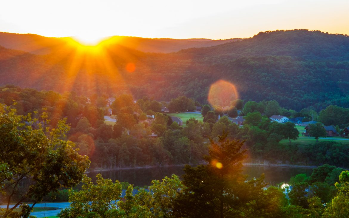Sun sets behind the lakes of the Ozark Mountains in Eureka Springs