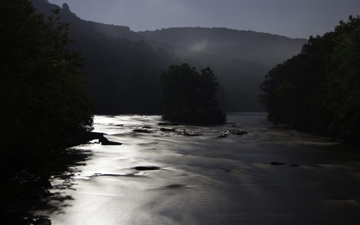 A moonlit landscape of the Youghiogheny river in Ohiopyle State Park.