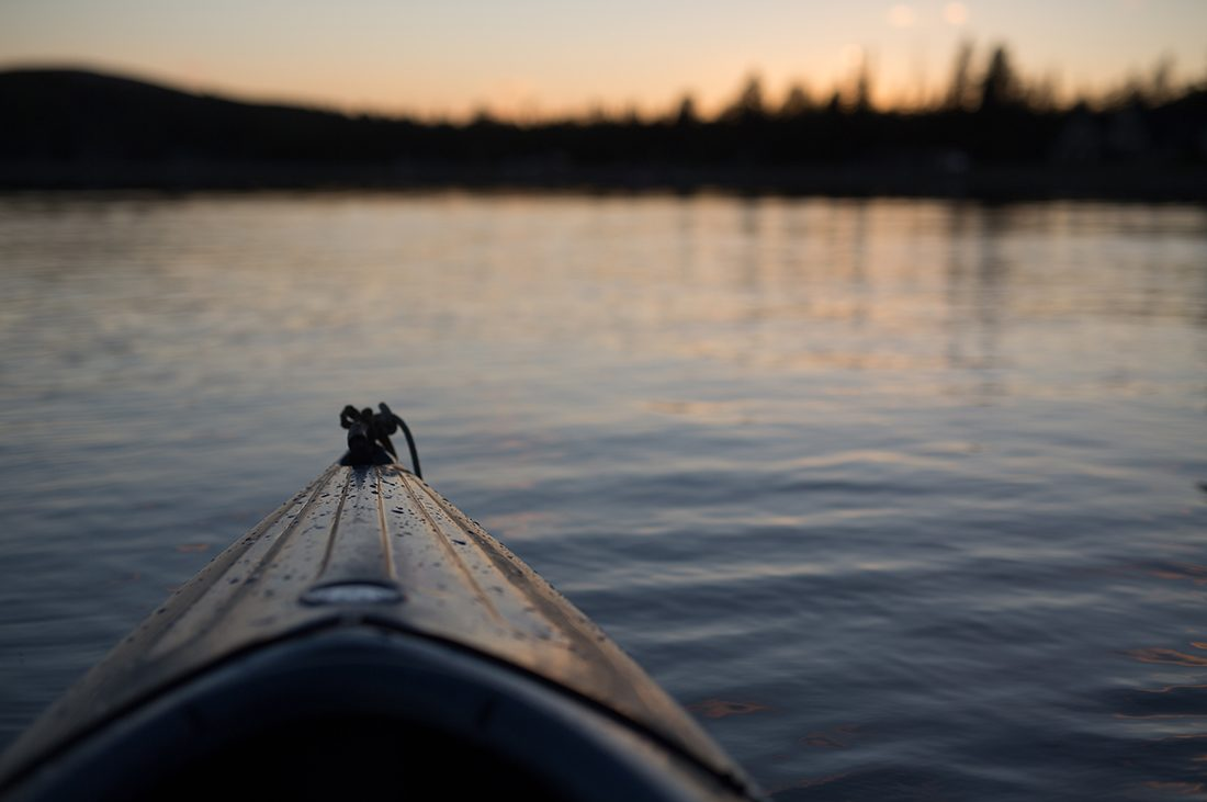 Pic of the bow of a kayak in placid water taken from the paddler POV.