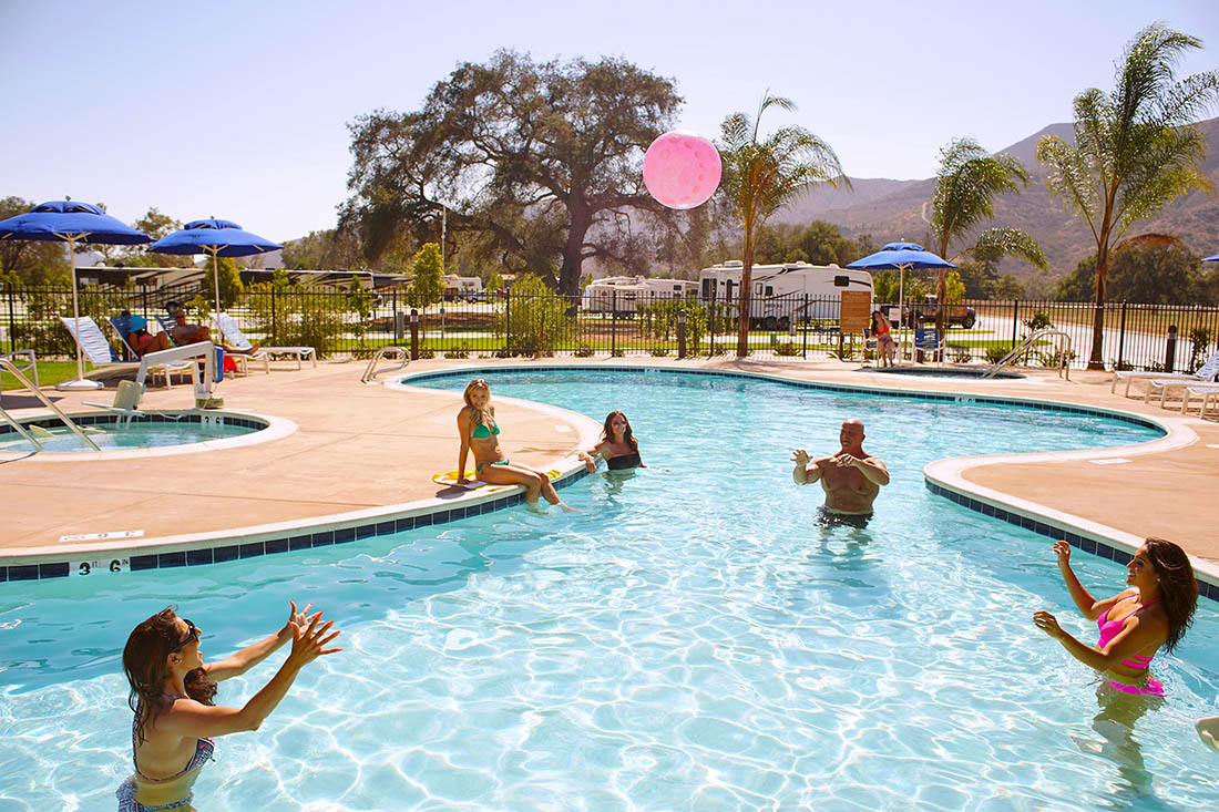 People toss a beach ball around in a pool at Pala Casino