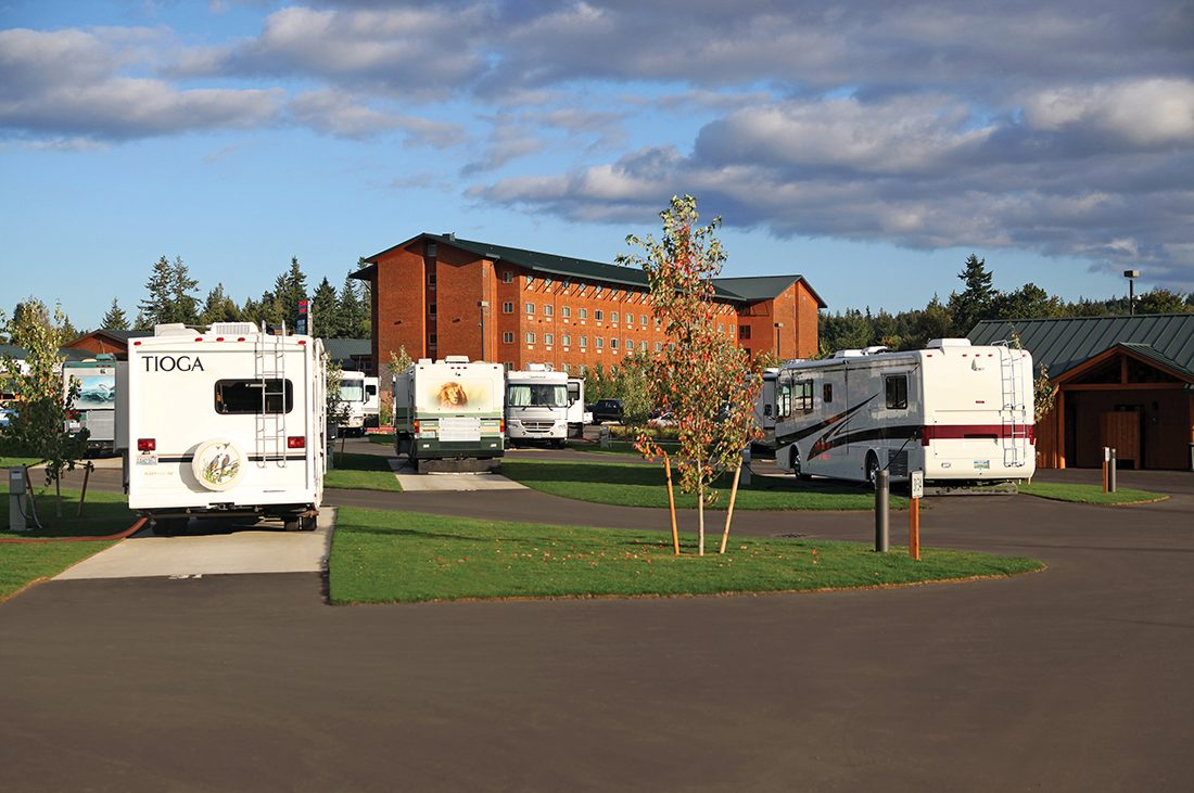 RVs parked in an RV resort with the Little Creek Casino in the background.