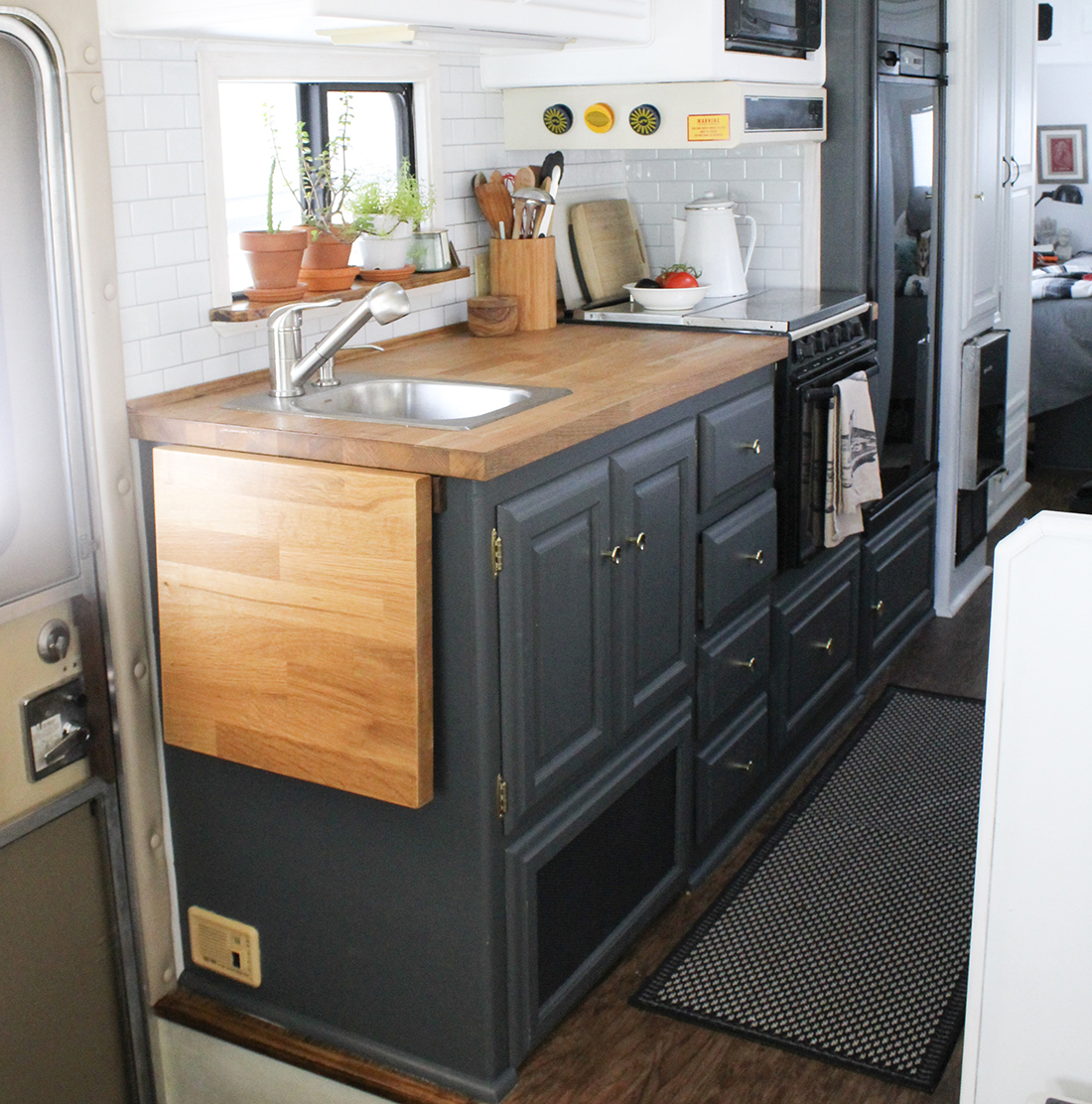 A rug covers the passage leading through the galley of a motorhome.