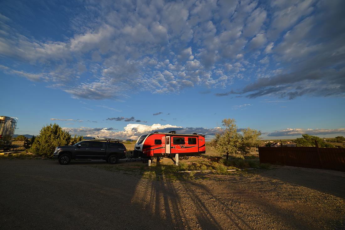 The sunset casts long shadows at Santa Fe Skies RV Park in Santa Fe, New Mexico.