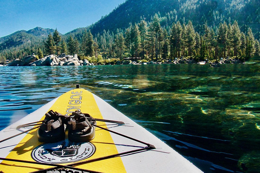 A Body Glove Kayak knifing through the clear waters of Lake Tahoe.