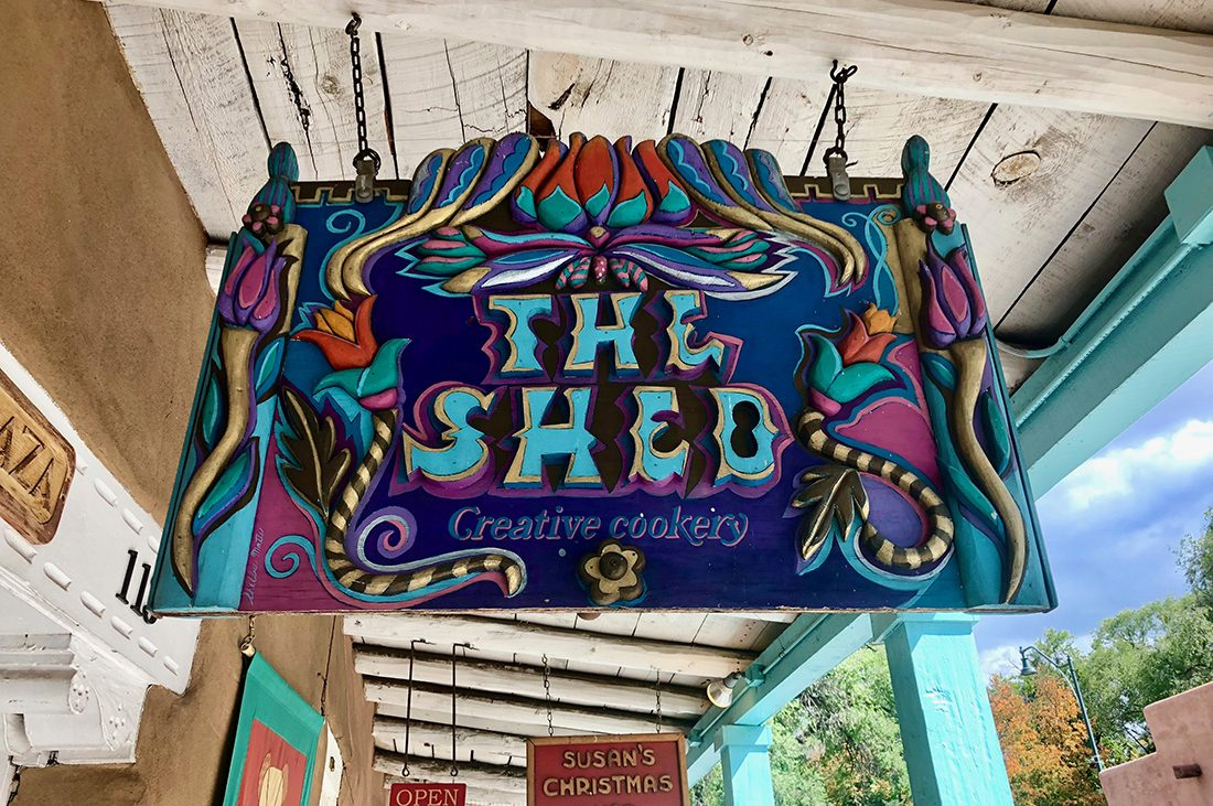 A colorful sign of The Shed restaurant in Santa Fe.