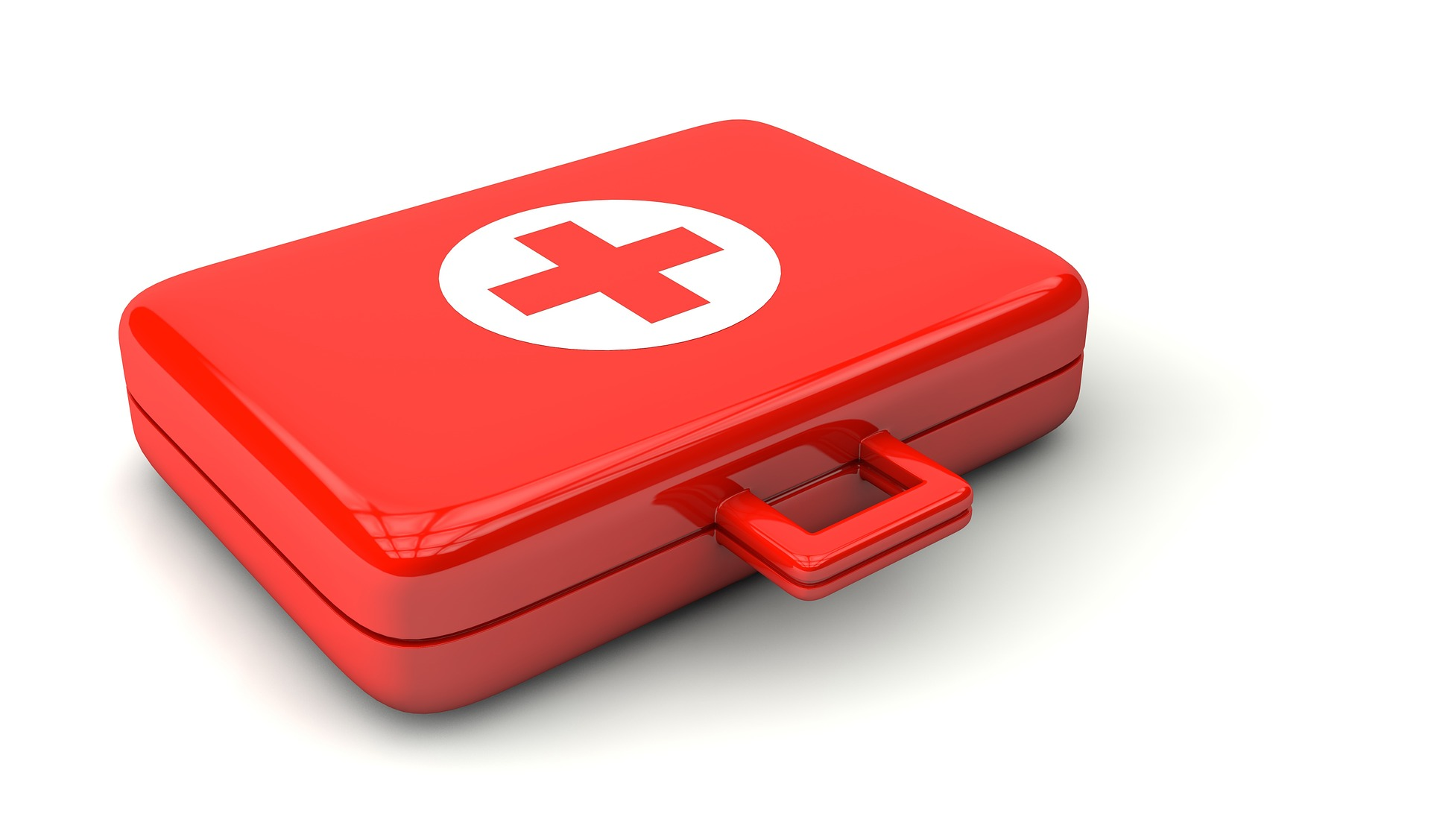A gleaming red first aid kit with a handle for easy carrying.