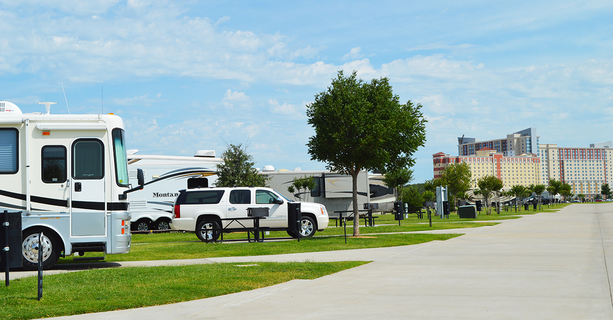RVs parked in concrete lots with the Winstar Casino in the background.