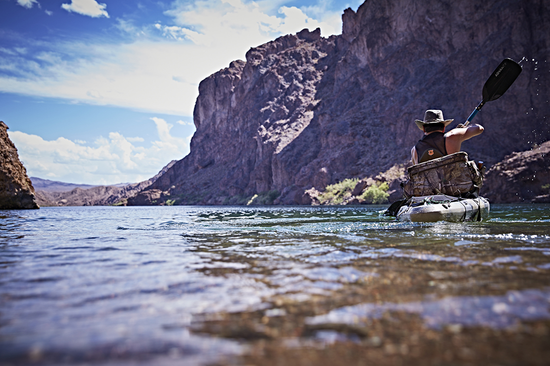 A lone kayaker plays the Colorado River.