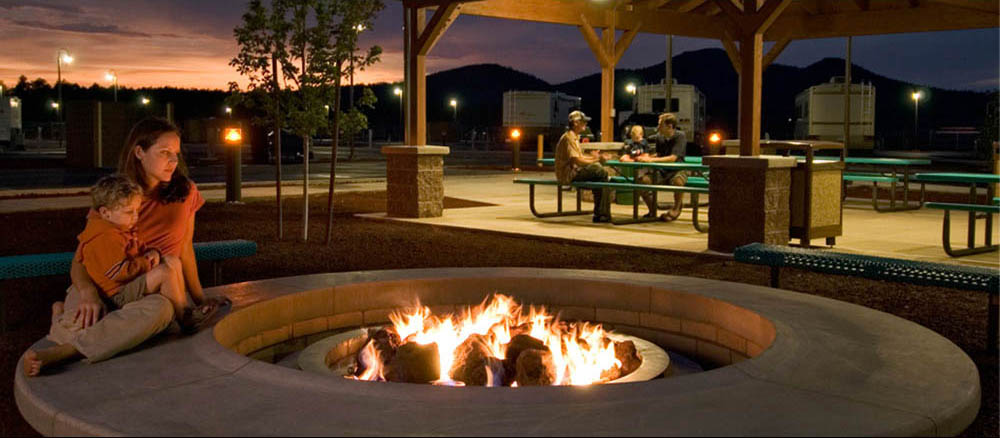 A mother and child contemplate a fire ring at the Grand Canyon Railway RV Park in Arizona.