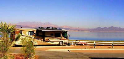 A motorhome overlooks Lake Mead with mountains looming in the background.