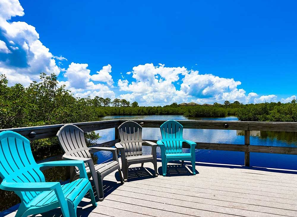 Patio chairs near lake on sunny day in Florida