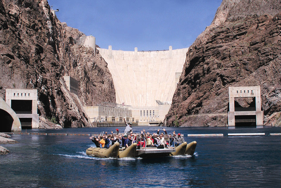 Rafters wave to the camera at the foot of the Hoover Dam.