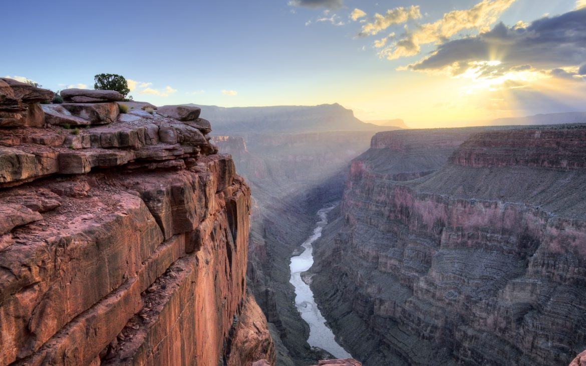 Gorgeous sunrise view over Grand Canyon, with stream running in the middle