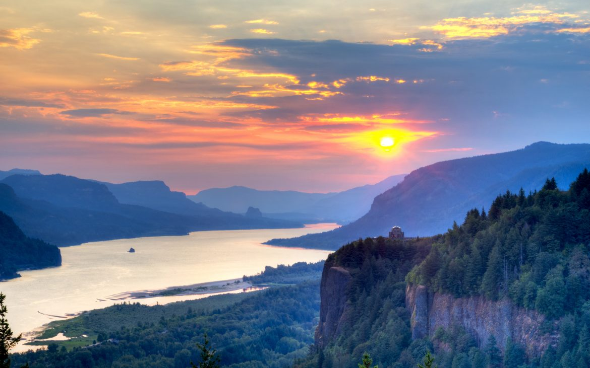 Beautiful lake and mountains with rising sun over Columbia River Gorge