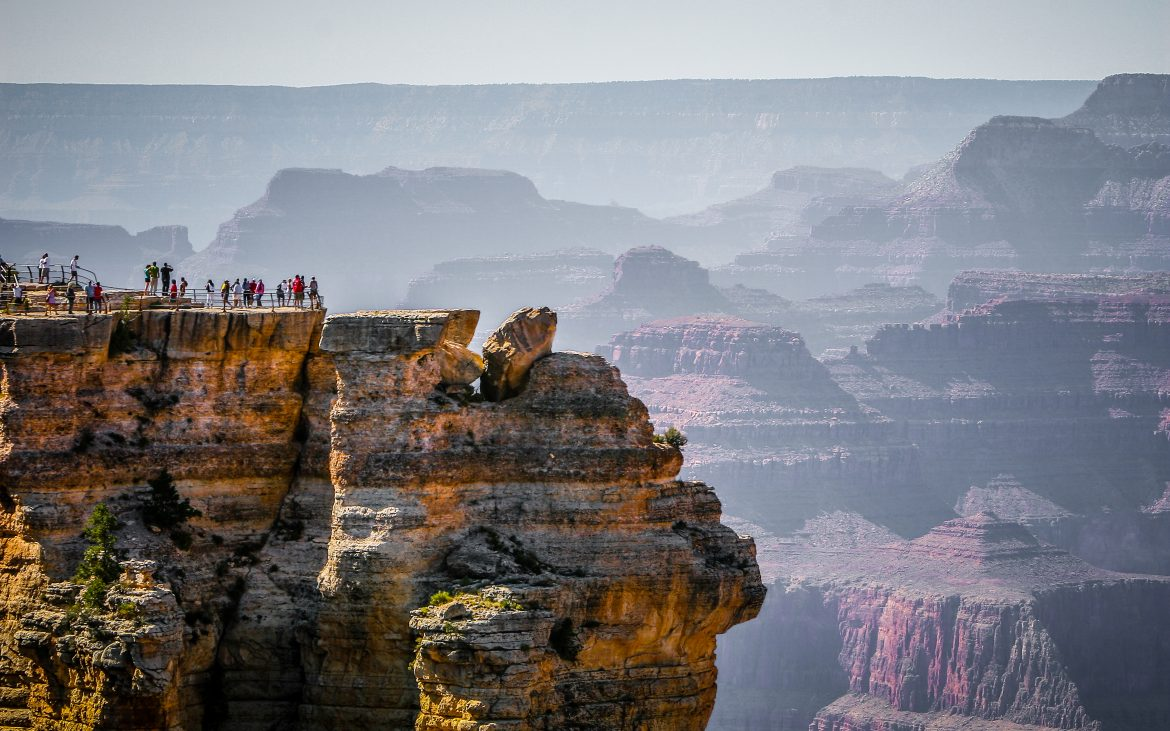 Majestic view of Grand Canyon, layers of tan, brown, purple rock