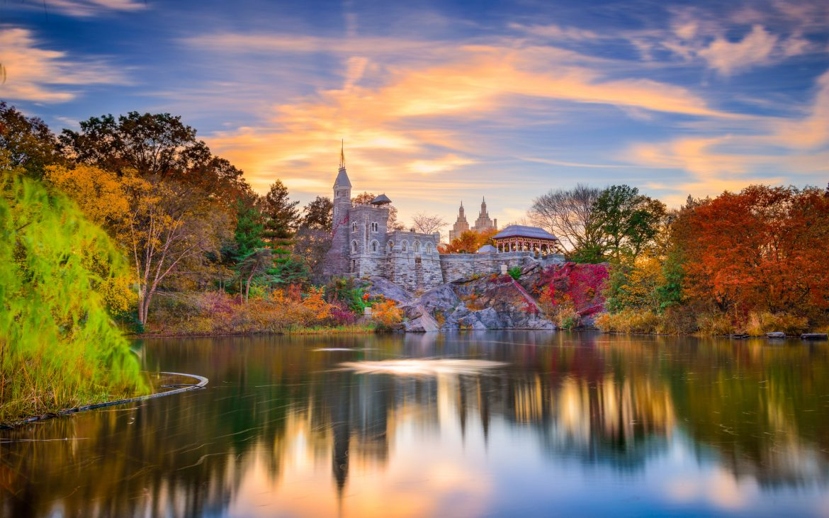 Autumn sunset of Belvedere Castle and reflections in lake and colorful trees surrounding
