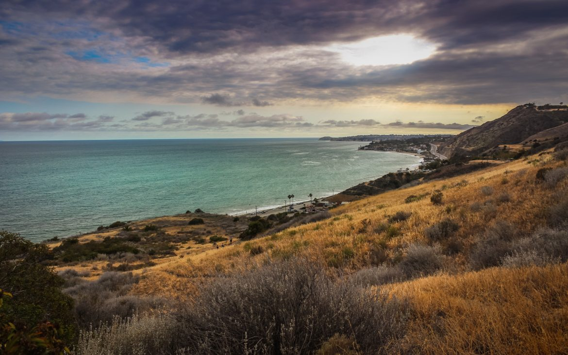 Dramatic clouds and coastline view of the Pacific Ocean from the Corral Canyon trail in Malibu