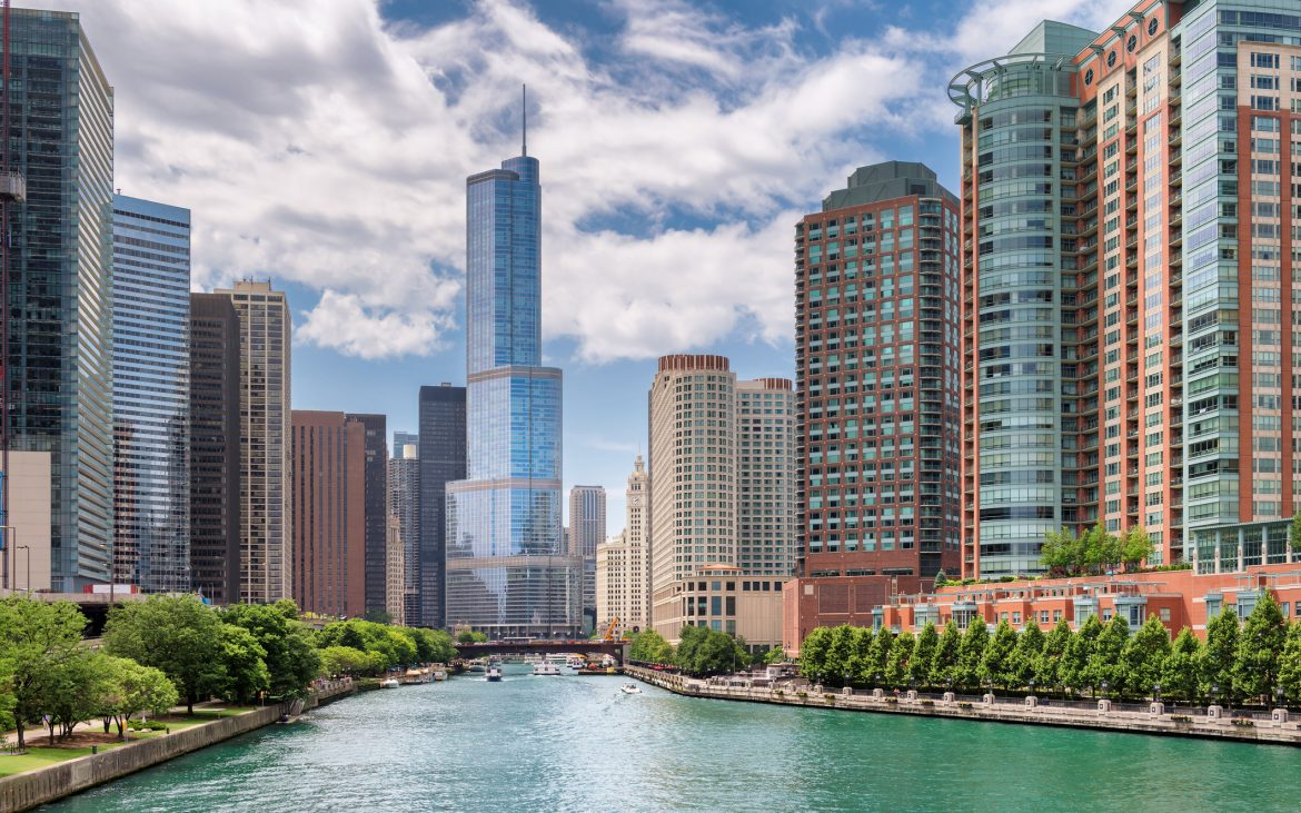 Aerial view of Chicago River in the middle of skyscrapers during summer