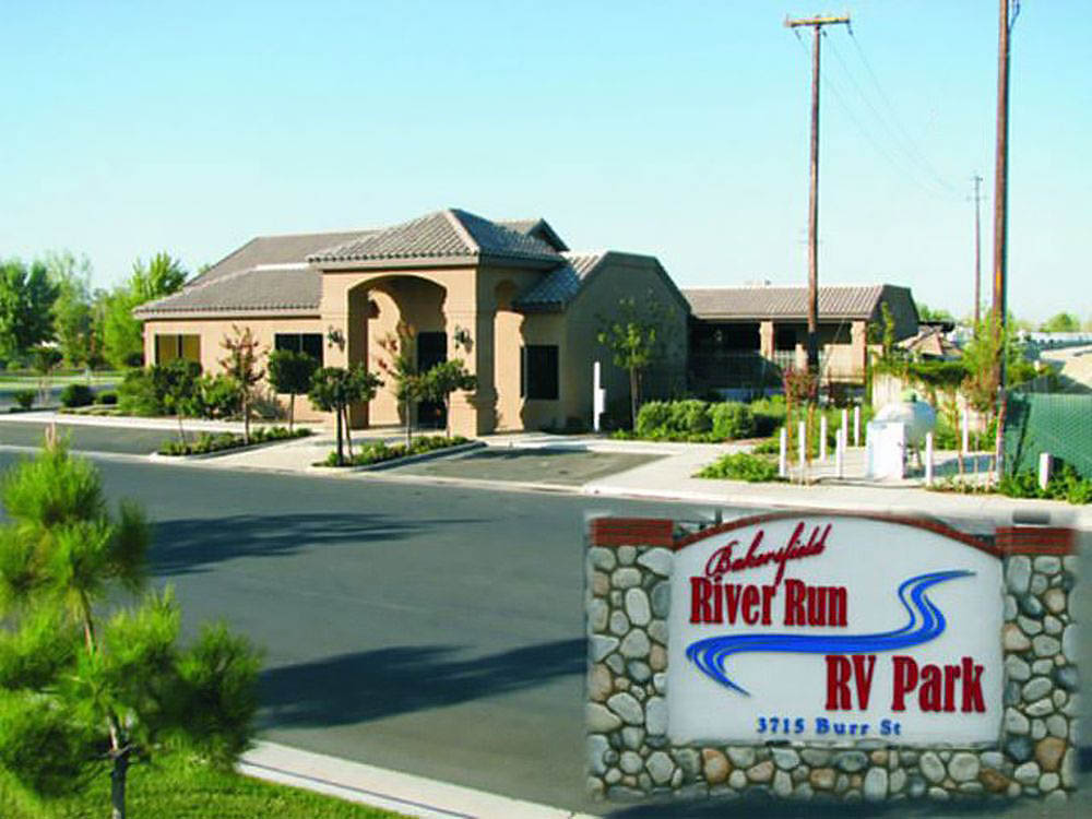 Sign for Bakersfield River Run RV Park in front of park office.