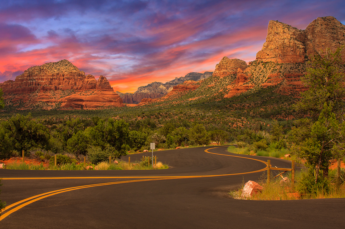 A road leading into the red rocks of Sedona, Arizona.