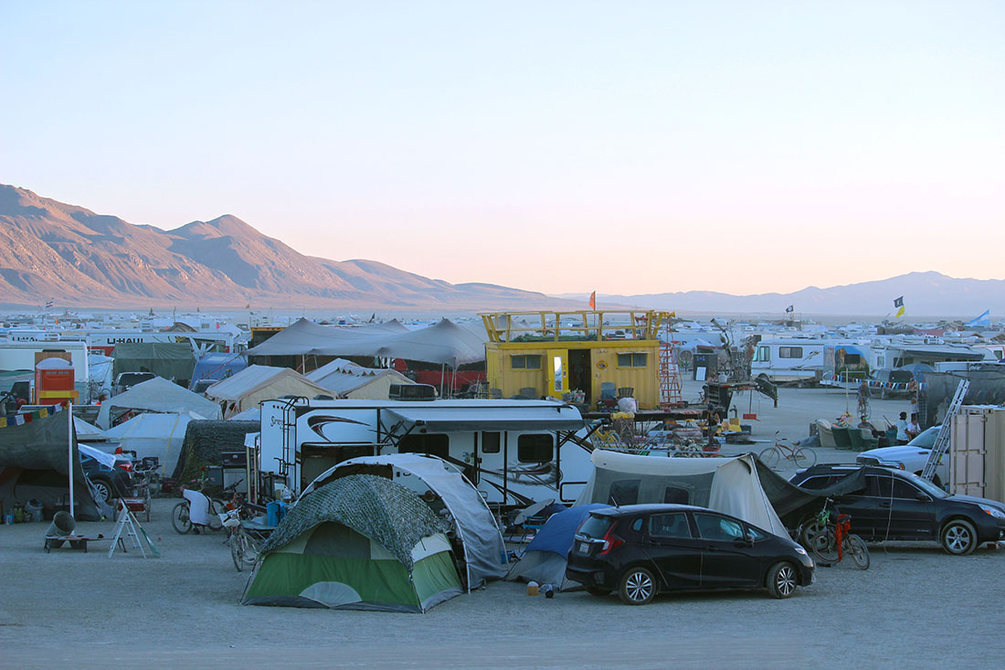 A sea of colorfully adorned RVs stretch into the horizon.