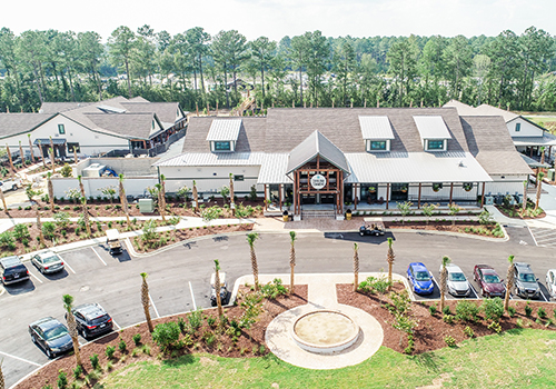 fall campground offers — An aerial shot of the office building with an a-frame entrance in a luxury RV park.
