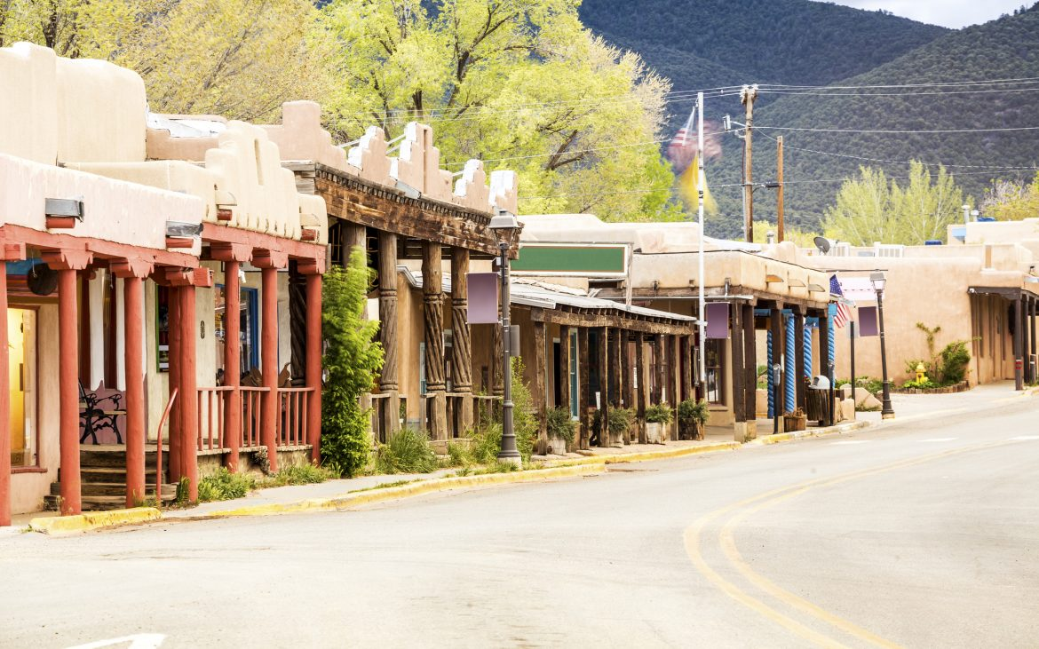 Old and colorful building in Taos on empty street