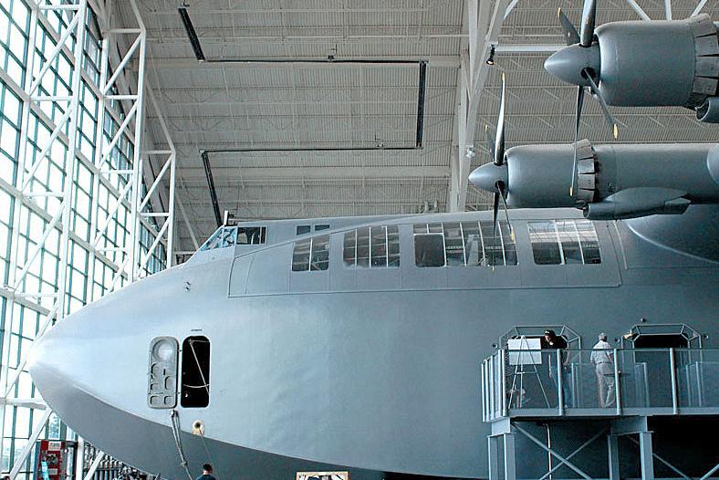 Huge WWII era cargo plane in a hanger.