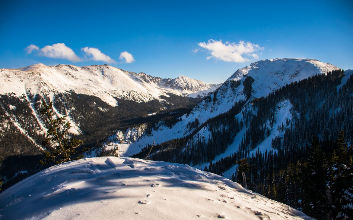 Beautiful snow covered ski mountains at Taos Ski Valley on sunny day