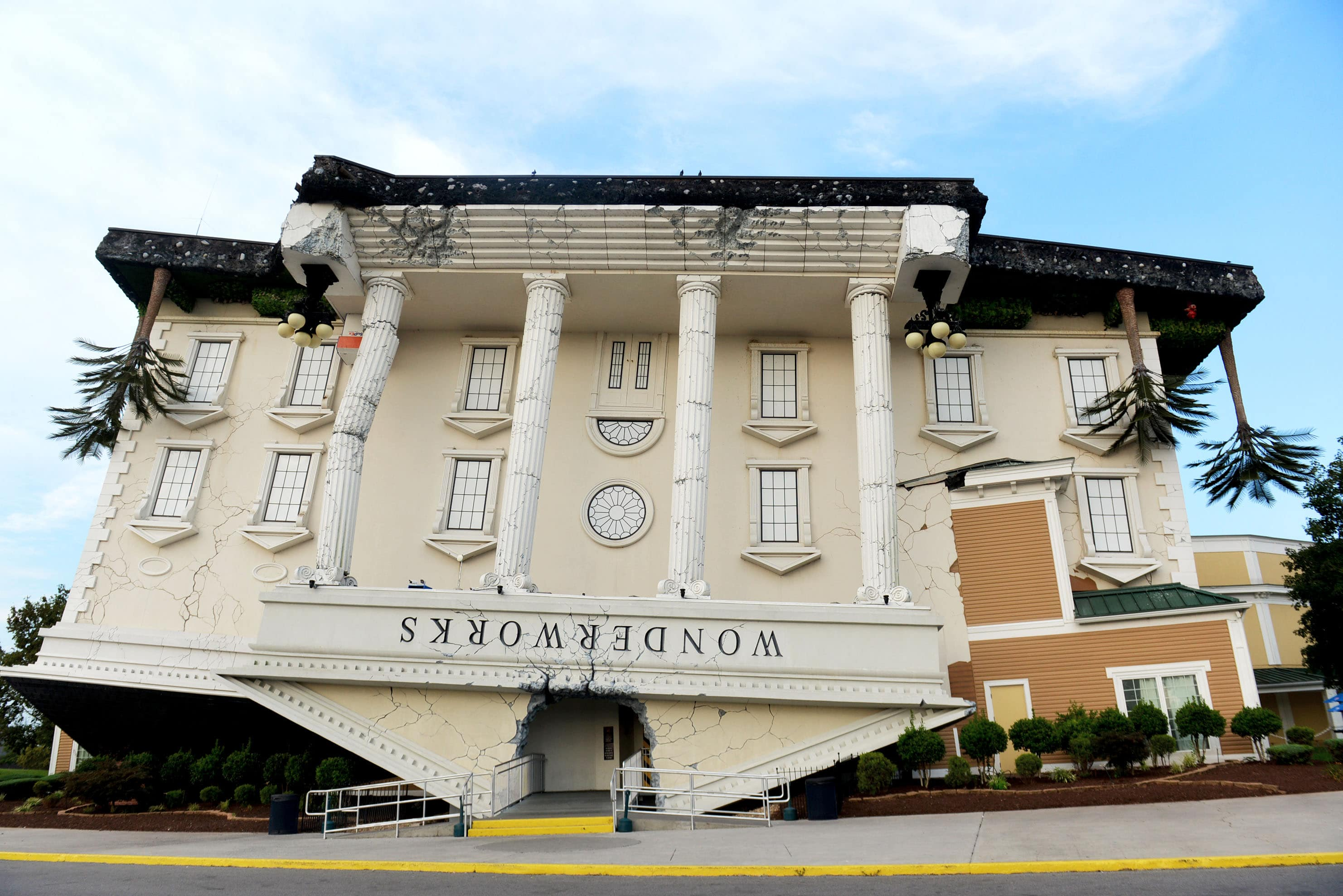 "An upside-down building emblazened with ""wonderworks."""