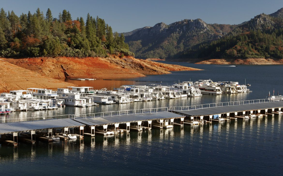 Marina on the McCloud River arm of Lake Shasta with boats on sunny day