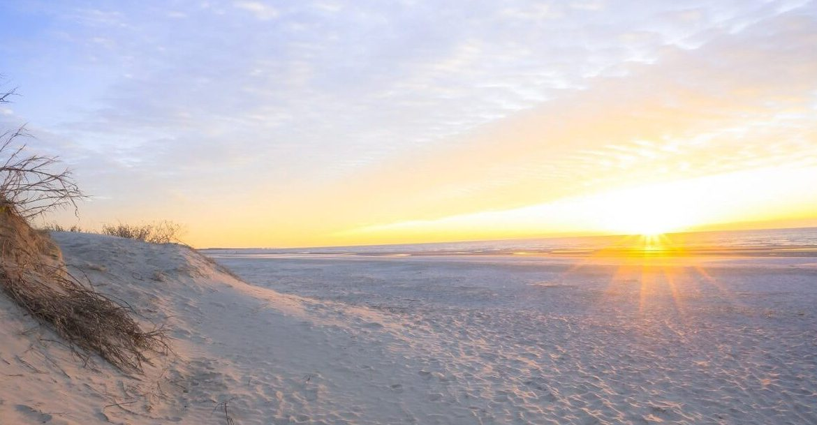 Beautiful sunset over white sandy beach