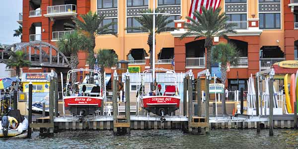 Leisure boats are ready for action along Harborwalk Village.