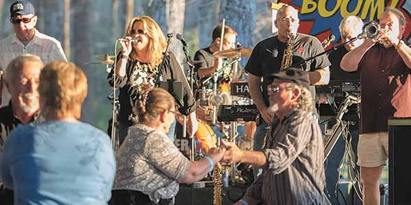A band plays and revelers dance in a Louisiana Festival.