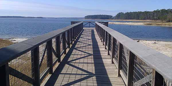 A wooden walkway leading to an observation deck.