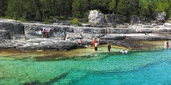 People playing in the clear water off the Northern Bruce Peninsula.