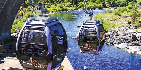 The Riverfront Park Skyride gondola lift carries riders above the Spokane Falls for aerial views.
