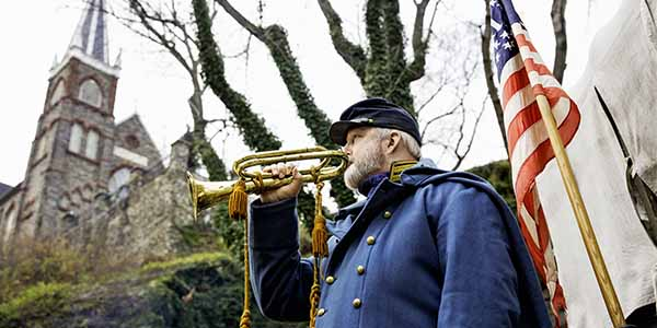 A bugler signals fellow troops in Harpers Ferry.