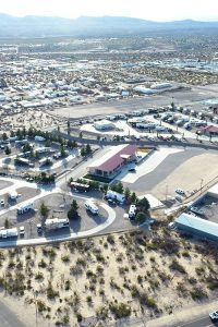 An aerial shot of an RV park with surrounding town.