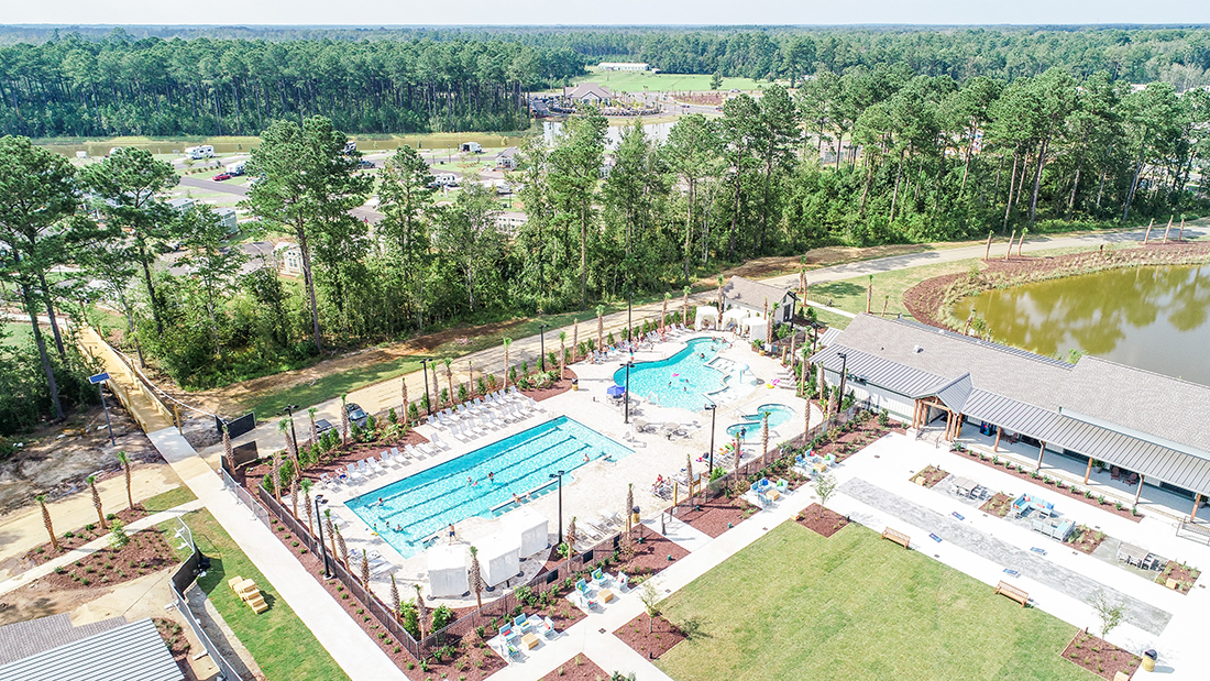 carolina pines in myrtle beach sc — an aerial view of an RV park with two pools near a pond.